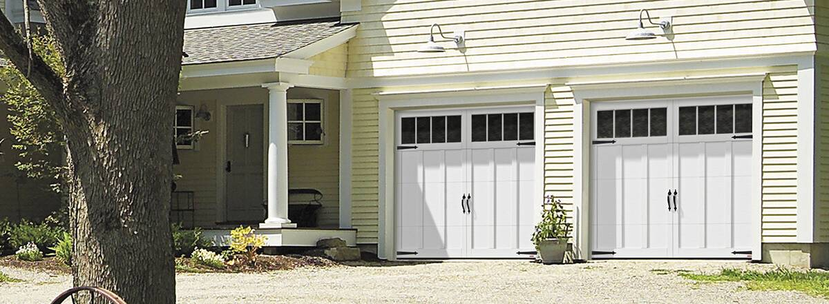 Eastman E-13, 9' x 7', Ice White doors and overlays, 4 vertical lite Panoramic windows